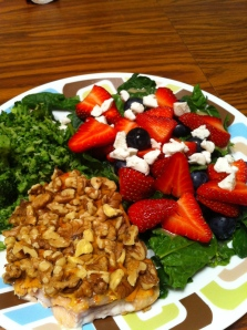 Walnut-crusted salmon, spinach salad topped with berries and honey mustard. Side of broccoli.
